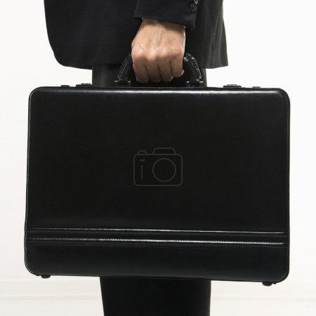 Businessman holding briefcase.