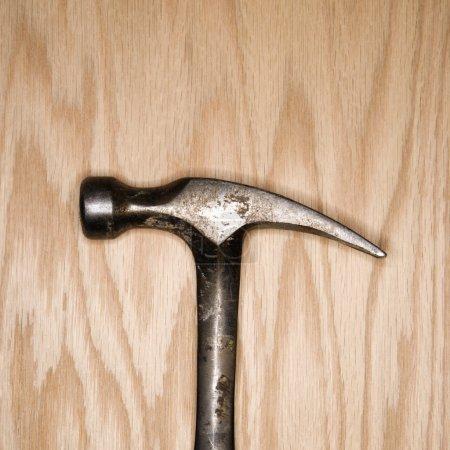 Hammer on wood.