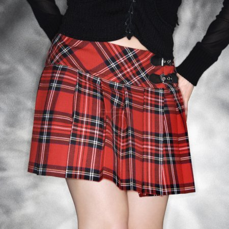 Woman in plaid skirt.