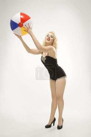 Woman with beach ball.