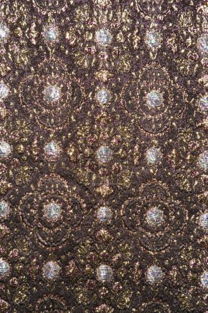Photo for Close-up of textural vintage fabric with repetitive shapes and metalic thread stitching. - Royalty Free Image
