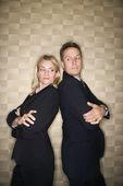 Business-Mann und Frau Rücken an Rücken