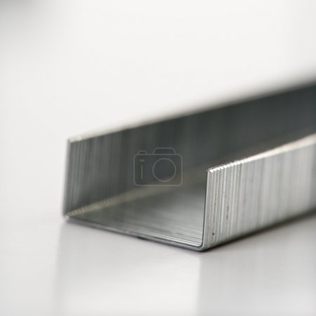 Photo for Close up of a row of new staples. - Royalty Free Image