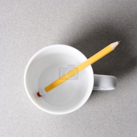 Pencil in coffee cup.