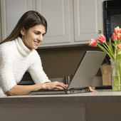 Woman with laptop.