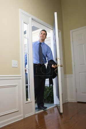Businessman coming home.