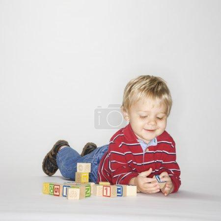 Boy playing with blocks.