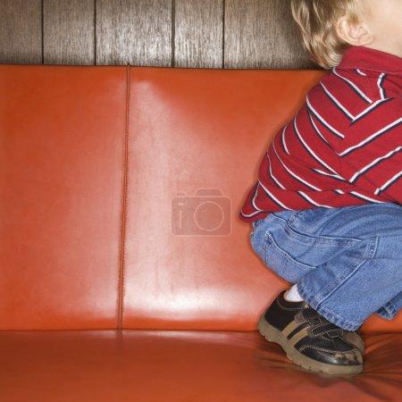 Boy on sofa.