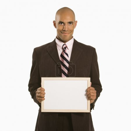 Businessman holding blank sign.
