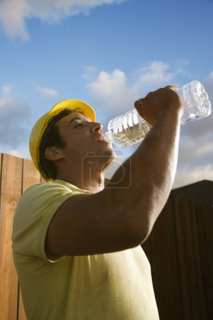 construction worker drinking water