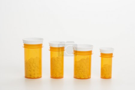 Yellow Medicine Bottles With Pills. Isoated