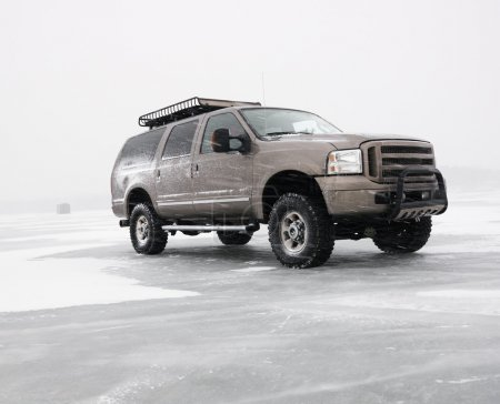 Truck on frozen lake.