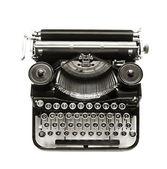 Antik írógép a fehér hátteret