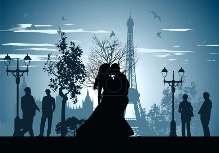 Man and woman kissing on a street in Paris