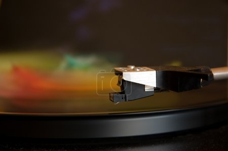70's model turntable playing colourful music