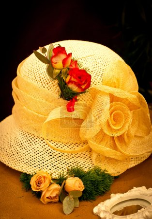 Yellow hat with roses