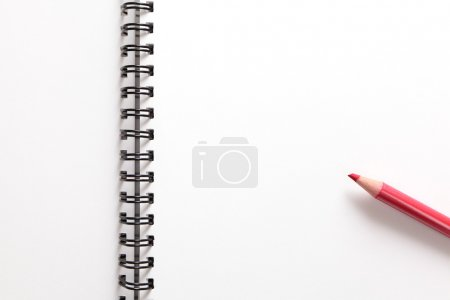 Notebook and red pencil
