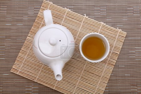 Photo for Healthful green tea and teapot for afternoon tea time - Royalty Free Image