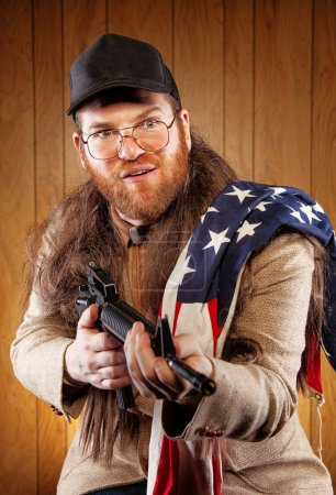 Southern Hick with a rifle and flowing hair flag