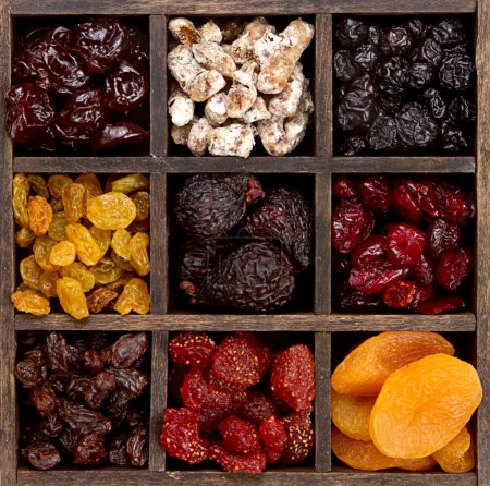 Assorted dried fruit in a printers box