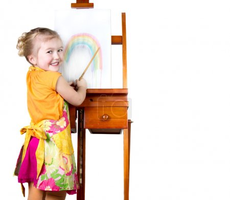 Little girl painting a rainbow