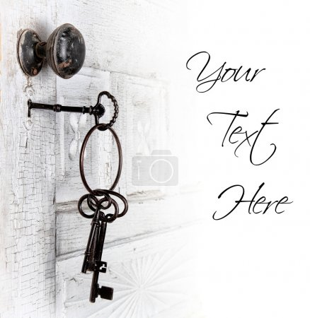 Photo for Antique door with keys in the lock isolated area for text - Royalty Free Image