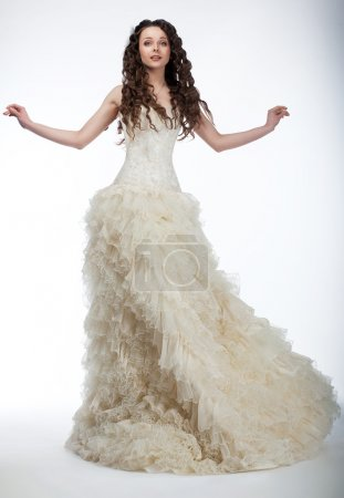 Sensual bride in lush white nuptial dress standing