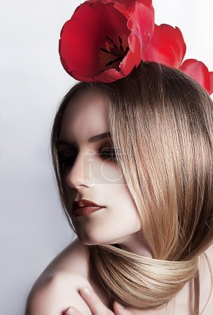 Love. Cute caucasian girl with flowers - red tulip
