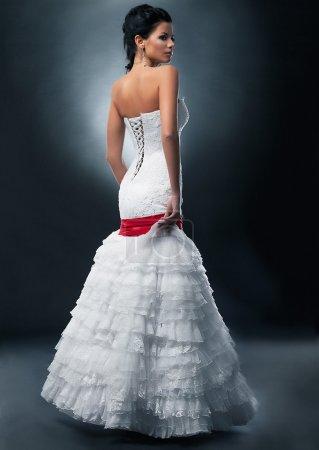 Imposing lovely fashion model bride in bridal dress studio shot