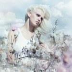 Постер, плакат: Spring landscape attractive gentle blonde girl in flowering meadow