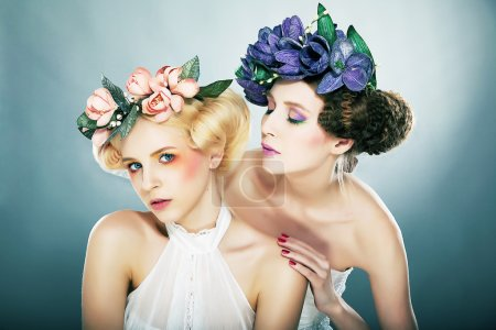 Lovely fairies - blonde and brunette in colorful wreaths posing