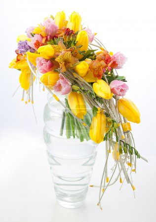 Colorful flowers bouquet arrangement centerpiece in transparent vase