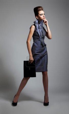 Beauty - fashionable young slim female posing in studio