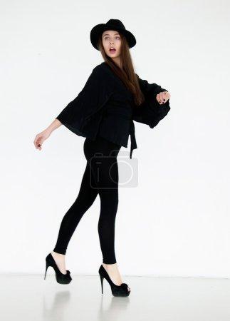 Glamorous female in black retro garments posing