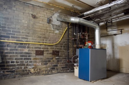 Boiler in basement ; industrial dirty grunge background