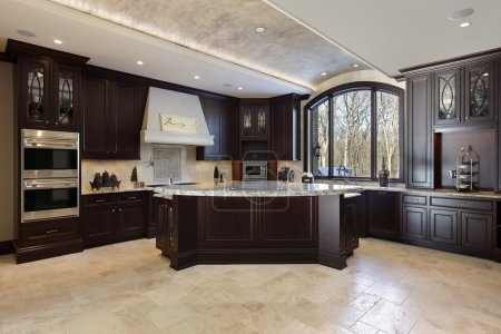 Photo for Large kitchen in luxury home with dark wood cabinetry - Royalty Free Image