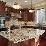 Kitchen with granite island and cherry wood cabine...