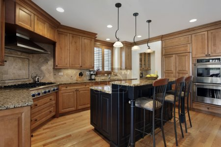 Photo for Luxury kitchen with granite island and wood cabinetry - Royalty Free Image