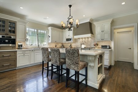 Photo for Kitchen in luxury home with white cabinetry - Royalty Free Image