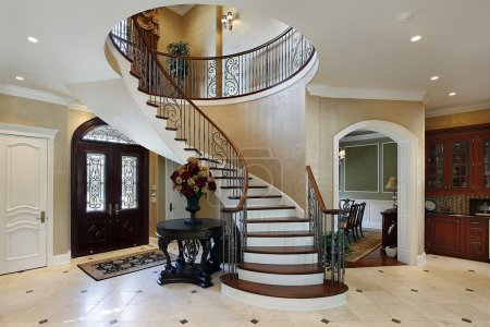 Photo for Foyer in luxury home with circular staircase - Royalty Free Image