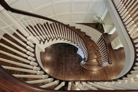 Photo for Spiral staircase in luxury home with wood railing - Royalty Free Image