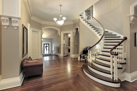 Photo for Foyer in traditional suburban home with curved staircase - Royalty Free Image