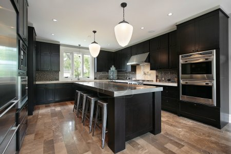 Photo for Kitchen in luxury home with dark wood cabinetry - Royalty Free Image