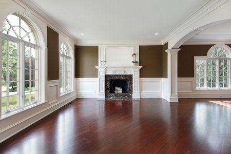 Living room in new construction home with cherry w...