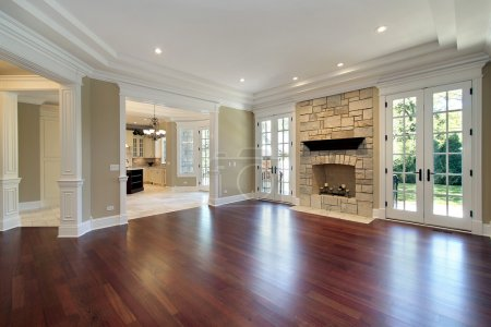 Living room in new construction home with stone fi...