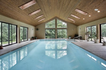 Photo for Indoor pool in luxury home with skylights - Royalty Free Image