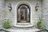 Arched stone entry to luxury home