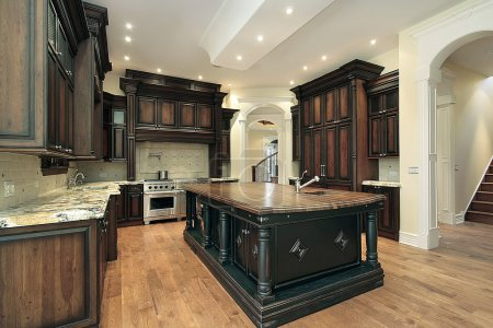 Kitchen with dark cabinet