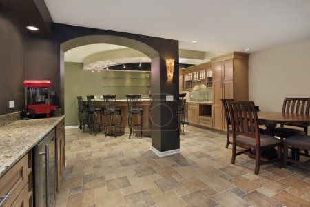 Photo for Lower level basement with bar and chairs - Royalty Free Image