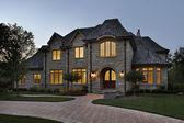 Luxury stone home at dusk